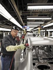 Nima Farzaneh works a buffer on the production line at Nissan's plant in Smyrna.