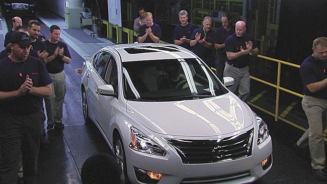 Nissan employees celebrate production of the fifth generation of the automaker's top-selling Altima, which is built at its Smyrna plant. Nissan is working to make its vehicles lighter to comply with new national fuel standards.