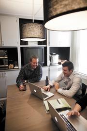 """Account executive Brandon Terpstra, left, enjoys a beer with co-worker Kevin Rogers, director of sales, at Concept Technology Inc. """"We work hard all week. It's nice to enjoy a drink with your co-workers to celebrate a job well done,"""" Terpstra said. The company picks up six-packs to wrap the work week."""