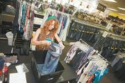 Taylor Mulliniks, a stylist with Plato's Closet in Franklin, prepares merchandise for customers. Plato's Closet is one of a number of businesses that are finding big profits in resale consumer items in the wake of the Great Recession.