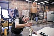 Production manager Travis Hixon checks the alcohol proof at the distillery.