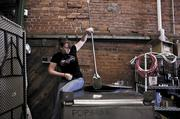 Destiny Whinnery works on the fermenters at the Marathon distillery for Popcorn Sutton's Tennessee White Whiskey.