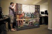 Marketing coordinator Bradley Minnigan works with merchandise.