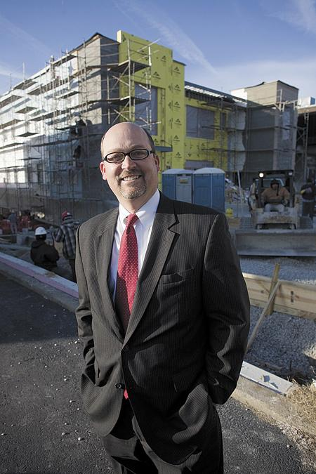 InsBank President and CEO Jim Rieniets stands in front of the bank's new headquarters, which is being built in Green Hills.