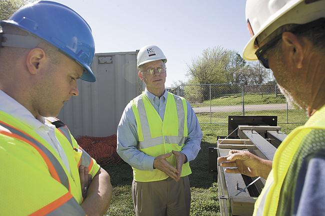 Rock City Construction President John Lee, center, talks with site superintendent Sonny Nicholson, right, and Lose and Associates project manager Michael Black. In preparing a succession plan for his business, Lee has been setting aside cash to help the company cover state inheritance taxes.