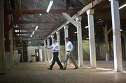 Ronnie Wenzler, left, and Allen Arender inspect the Sawtooth Building near the Tennessee State Fairgrounds.