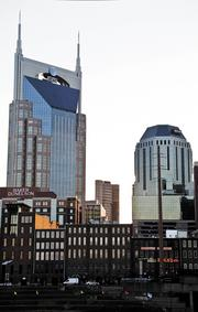 Nashville's skyline includes many buildings with prominent signage.
