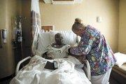 Nurse Jannell Emerson checks on patient Frances Boone at Sumner Regional Medical Center in Gallatin.
