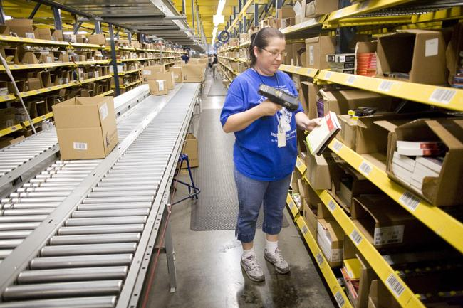 Sonia Torres scans books at Thomas Nelson Inc.'s distribution warehouse on Nelson Place Drive. The Nashville-based Christian publisher, which sells books, CDs and DVDs around the world, supports duty relief.