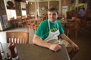 John Armour, owner of Three Stones Pub in Plantation Court, decided to reopen his restaurant after the flood, but four other businesses in the waterlogged shopping center have not returned.