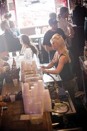 Aimee Kamp, a bartender and performer, serves customers at Tootsie's Orchid Lounge.