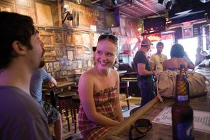 Dain Sherrard, left, and Danielle Durham, both of Louisville, spend time at Tootsie's Orchid Lounge in downtown Nashville. Tootsie's is one of several downtown bars that sees a significant revenue boost from the CMA Music Festival.