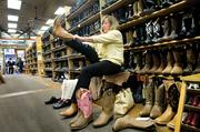 Susan Dain of Dallas, Texas, shops for boots at Boot County on Broadway in downtown Nashville. Dain and her husband are spending a few days in Nashville to celebrate their wedding anniversary.