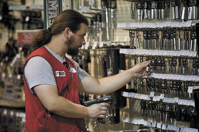 Michael Alexander, an employee of Tractor Supply Co. in Hendersonville, Tenn., stocks hand tools.