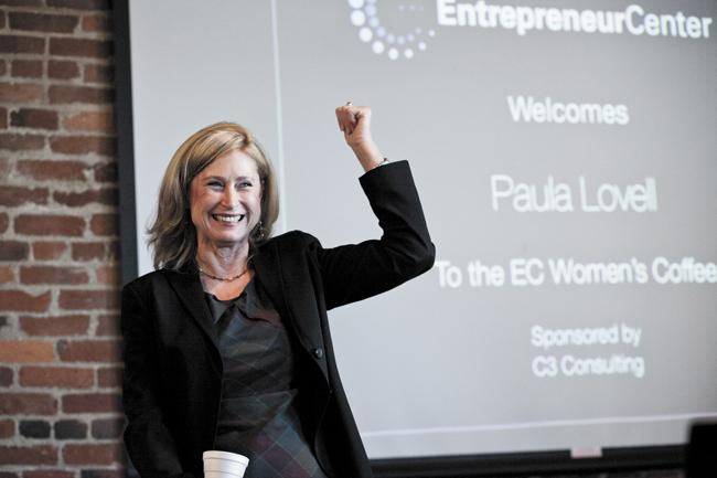 Paula Lovell, founder of Lovell Communications, speaks to fellow female entrepreneurs during the Women's Coffee at the Entrepreneur Center, a monthly networking event.