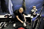 Cory Rexford and his 9-year-old son, Cole, gear up for a private hockey lesson at A-Game Sportsplex in Franklin.