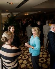 Jana Miller of Lowes Vanderbilt Hotel, top left, talks with Kara Allen, left, and Leisa Gill of LBMC PC talks with Rebecca Howald.