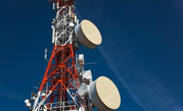 The telecom giants are shifting their spending from landlines to wireless infrastructure.