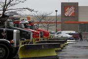 Trucks fitted with snow plows sit in the parking lot of a Home Depot Inc. store in Vauxhall, New Jersey, U.S., on Friday, Feb. 8, 2013. The New England cities are expected to receive more than 2 feet of snow by the time Winter Storm Nemo moves out tomorrow night, according to the weather service.