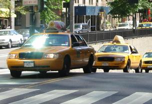 "New York City taxis will be available via ""e-hail"" starting in February."