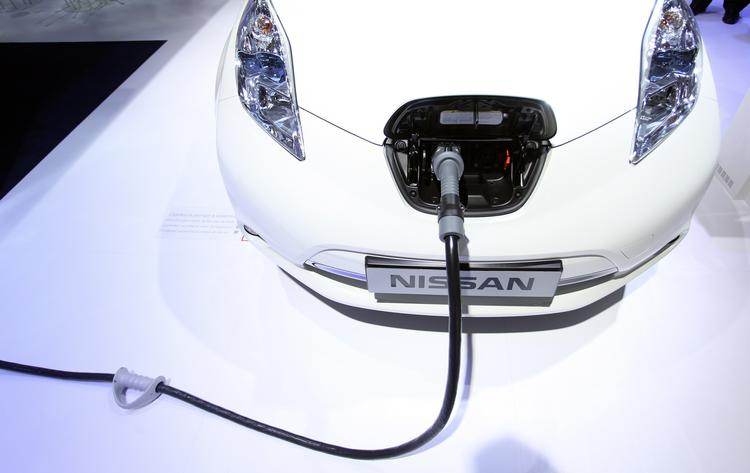 """The Leaf will be joining the Nissan NV-200 as the cabs of New York's future. """"Fueled"""" by electricity, the completely electric Leaf needs to be charged instead of filled (as shown above)."""