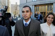 Mathew Martoma, a former portfolio manager at a unit of SAC Capital Advisors LP, left, exits federal court with his wife Rosemary Martoma in New York, U.S., on Thursday, Jan. 3, 2013. Martoma, charged in what prosecutors called the biggest insider trading scheme in history, pleaded not guilty to criminal charges.