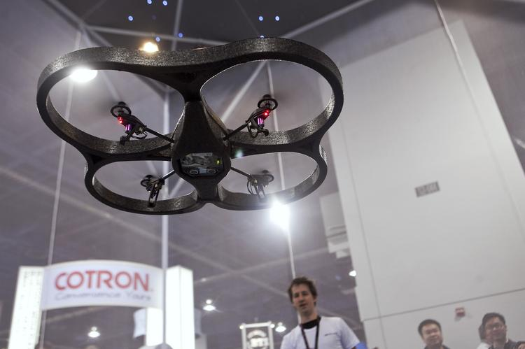 The Parrot SA AR. Drone, a quadricopter that can be remotely controlled by an Apple iPhone, hovers in the air during a demonstration at the 2010 International Consumer Electronics Show (CES) in Las Vegas.