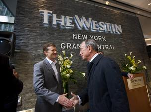Brian Povinelli, global brand leader of Westin Hotels & Resorts, left, shakes hands with Michael Bloomberg, mayor of New York City, during the grand opening ceremony for the Starwood Hotels & Resorts Worldwide Westin New York Grand Central in New York, U.