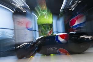 Bottles of various PepsiCo Inc. sodas are arranged for a photograph in San Francisco, California, U.S., on Wednesday, Feb. 13, 2013.