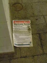 A posted alerting passengers to Hurricane Sandy on the floor at the South Ferry subway station.
