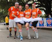 From left: Disney runners Matthew Malone, Claire Longest, Shannah Winn and Christina Haak strike a pose before the IOA Corporate 5K.