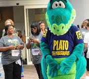 Plato the Publixaurus entertains the crowd before the IOA Corporate 5K.