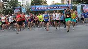 An estimated 14,000 runners make their way down Central Avenue at the start of the an estimated 14,000 runners at the starting line before the start of the IOA Corporate 5K.
