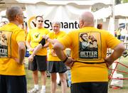 Runners from Symantec sport their company logo shirts.