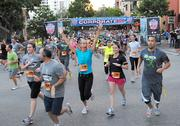 Runners from Campus Crusade for Christ make their way down Central Avenue at the start of the an estimated 14,000 runners at the starting line before the start of the IOA Corporate 5K.