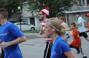 A runner dressed as Where's Waldo keeps pace at the IOA Corporate 5K.
