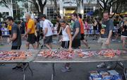 A runner takes an energy bar from the refreshment table at the end of the IOA Corporate 5K.