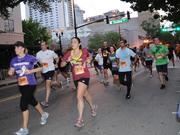 Runners make their way to the finish line at the end of the IOA Corporate 5K.