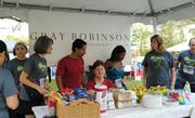 Volunteers set up at the Gray Robinson tent.