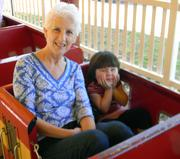 Ann and Sophie riding the zoo train