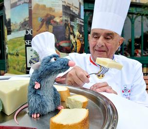 Chef Paul Bocuse with Remy from Ratatouille at Walt Disney World's France pavilion in Epcot.