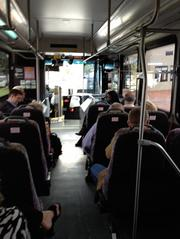 Attendees on board a Lynx bus returning to downtown from Kissimmee after the SunRail sneak peek ride and luncheon event.