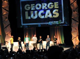 George Lucas (second from right) joins the cast of Star Wars Detours, an upcoming television comedy series based in the Star Wars universe, during a panel discussion at Star Wars Celebration 6.