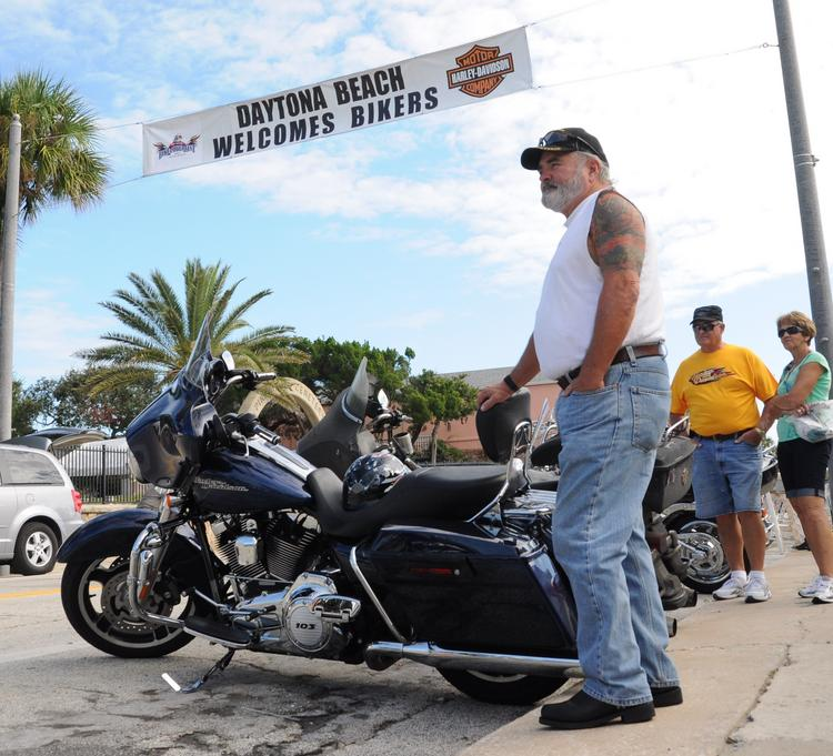 Jim Sawyer watches traffic roll down Daytona's Main Street on the first day of Biketoberfest. Sawyer, of Orange City, has attended all 20 of the events.