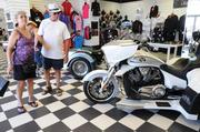 Biketoberfest shoppers browse the new showroom of Roar Motorcycles for Women on Beach Street. The dealership recently moved to the high traffic location on which many motorcycle dealerships and vendors enjoy good business.