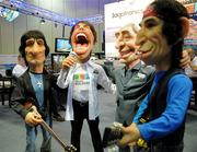 Caricature sculptures of The Rolling Stones at the Theme Builders booth on the IAAPA exhibitor floor.