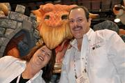 Janice Rentos and husband Dino ofThe Prop Magicianpose with a member of their staff at the company's exhibitor booth.