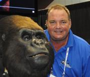 Curtis Henry and an animatronic prop made by his company Florida Creative Industries.