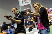 Kemal andLuna Tolunay of Fun Planners have a little fun on the IAAPA exhibitor floor while shopping for video game systems.