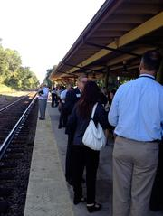 Participants in the SunRail sneak peek ride wait on the platform of the DeLand Amtrak station to board the train and experience what a SunRail ride will feel and look like.